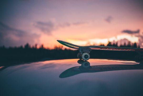 Skateboard on car in sunset